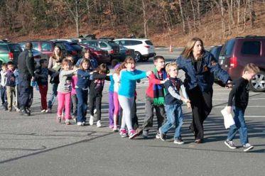 Students on morning of shooting in Newtown, CT. Newtown Bee photo.