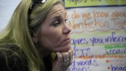 Wendy Lindman-Fechner listens to one of her third-graders offer suggestions on how to meet the day's personal goal.