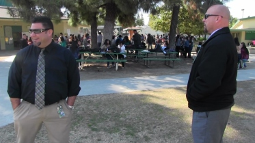 Reedley High School Principal Rodney Cisneros (l) and Learning Director Joseph Arruda (r) take a walk through the high school's commons during lunch.
