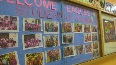 "The year's ""Super Me's"" on display in El Dorado Elementary School. Each week, one child from each grade level is chosen. ""They love it,"" says Principal Silvia Cordero. The awards are announced on the playground before schools starts every Friday morning. The kids scream with joy as each winner is announced."