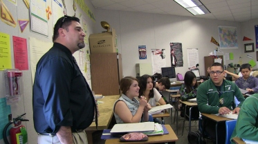 Reedley High School Principal Rodney Cisneros visits a math class.