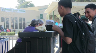 Students line up to buy lunch in Reedley High School plaza.