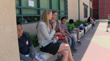 On either side of Lauren Maher (on left) and Pia Escudero, students sit out dance rehearsal after becoming disheartened.