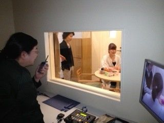 A typical setup for a PICT training, in which a counselor monitors interaction between parent and child.