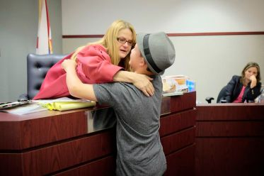 Judge Lynn Tepper hugs Taylor, 11, at his final adoption hearing. Before finding his permanent home, he'd been returned by three families since being removed from his biological mother when he was three years old.