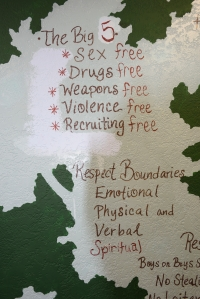 "In an effort to reframe messages more positively, SDYS Storefront Shelter staff and youth whited out the ""No"" in front of sex, drugs, weapons, violence, or recruiting, and replaced it with ""sex, drugs, weapons, violence, and recruiting free."""