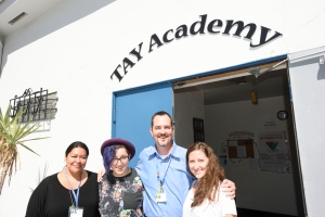 Staff of the San Diego Youth Services TAY Academy welcome all Transition Age Youth (TAY) to drop-in. Left to right: Vanessa Arteaga, Indie Landrum, Stephen Carroll, and Gillian Leal.