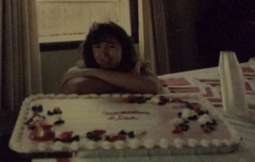 Leisa at graduation celebration, 1987