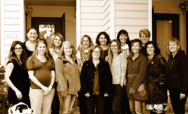 The Combined Child & Family and School-Based Clinical Team. From left: Ratchet; Elizabeth Fitzgerald, clinical supervisor SBHC; Kelsey Dunlap, clinician; Amy Richardson, clinician; Misty Groom, Safe-School assessor; Tracey Sanders, administrative assistant; Janice Garceau, program manager; Maryanne McDonnell, clinical supervisor; Jill Montecucco, clinician; Marie Jackson, SBHC clinician; Jodi Love, clinician; Jaymie Kaczmarek, SBHC clinician; Jennifer Noble, SBHC clinician; Tracey Colocicco, clinician; Deb Stone, clinician.
