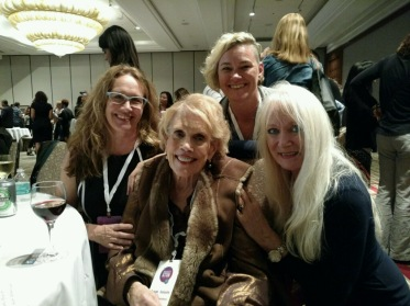 Susan Salasin, pioneer in ACEs and trauma-informed movement, is surrounded by ACEs Connection Network staff, including Sarah Rock (l), Dana Brown (r), and standing behind Susan, Jennifer Hossler.
